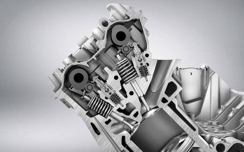 7- Questa sezione della testa di un moderno motore Mercedes Benz illustra a perfezione lo stato dell'arte nel settore delle distribuzioni dei modelli di serie di alte prestazioni