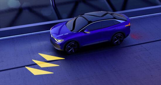 La ID Volkswagen proietta a terra le proprie intenzioni e fa capire anche se a condurla sia un umano o la sua AI