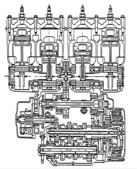 Questa sezione del motore Yamaha TZ 750 a quattro cilindri (largamente impiegato dai nostri piloti di punta) consente di osservare chiaramente le principali caratteristiche costruttive come i due alberi a gomiti di tipo composito in presa con l'ingranaggio dell'albero ausiliario, collocato centralmente, e gli otto cuscinetti di banco